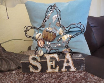 Starfish Wire, Beads and Shells Sculpture on Wood Stand With the Word Sea