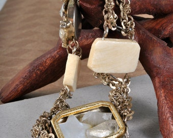 Cosmic Clock - Bone and gold bracelet with sun and moon charms, quartz and vintage pieces.