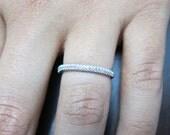 18K white gold micro pave diamond band.