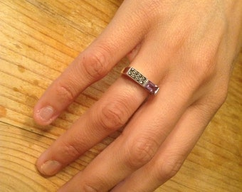 Estate find: Modern, silver,  marcasite and amethyst ring.  Approx size 7.