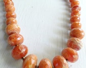Necklace chunky amber plastic faceted beads and brass beads Avon