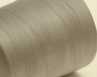 Large spool of vintage pale gray sewing thread