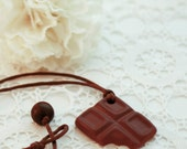 milk chocolate ceramic pendant