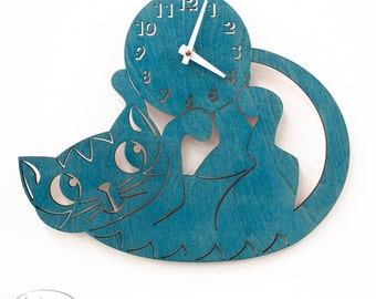 "The ""Playfully Turquoise/Teal Kitten"" designer wall mounted clock from LeLuni"