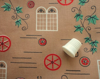 red and green on tan novelty print vintage cotton fabric -- 35 wide by 1 1/3 yards