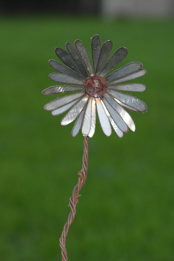 Single metal flower with barbed wire stem