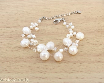 White freshwater pearl bracelet with Swarovski crystal on invisible thread