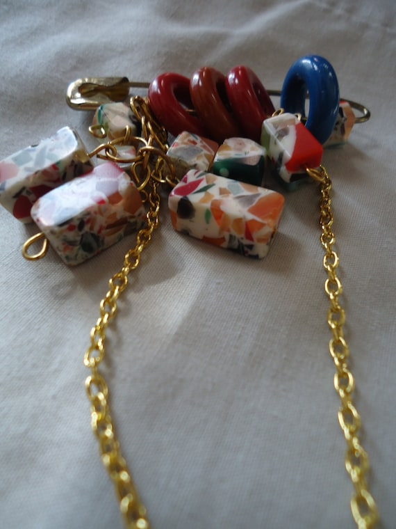 The Big Top Clown: pin with red and blue hoops, multi-colored beads, gold chain
