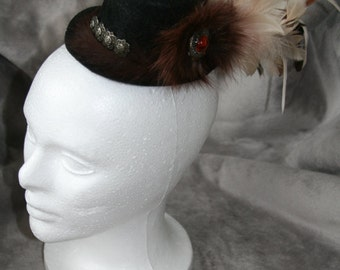 Gothic Mini Hat with with Feathers, Faux Fur Medallion, and Silver Accents