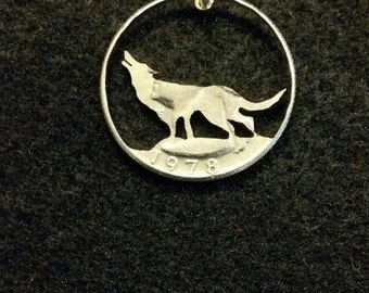 Wolf coin jewelry pendant cut from a quarter coin