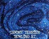 Howling at the Moon - a midnight blue glass fleck polish with blue, silver, and holographic shimmer