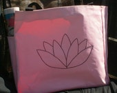 Light pink, hand embroidered polyester tote bag featuring a hand stitched Lotus design in black cotton thread. Perfect for gym or market.