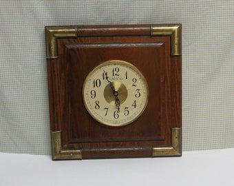 Oak Wall Clock Trimmed in Brass by New Haven