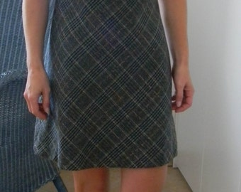 Sleeveless dress in wool with black top and gray and black plaid skirt