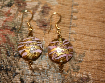Murano style, gold and pink colored, disc shaped earrings.