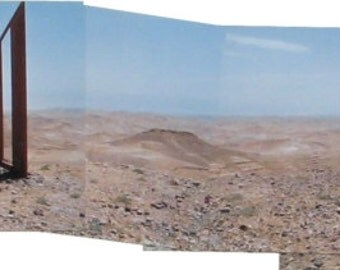 360 degrees view of the desert with interesting sculptures and a glimpse of the city of Arad, Israel