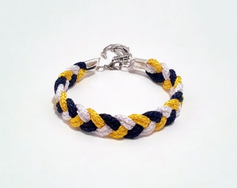 Navy blue, white and yellow braided nautical rope bracelet with silver anchor charm
