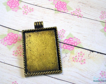 1 Rectangle pendant blank base setting, brass (antique bronze) plated, for 27x35 mm cabochon, rustic oxidized finish, roped edges frame.