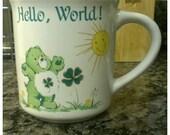 Sweet Vintage Care Bears Beverage Mug feat. Good Luck Bear by American Greetings