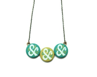 Green Ampersand and Foliage Necklace