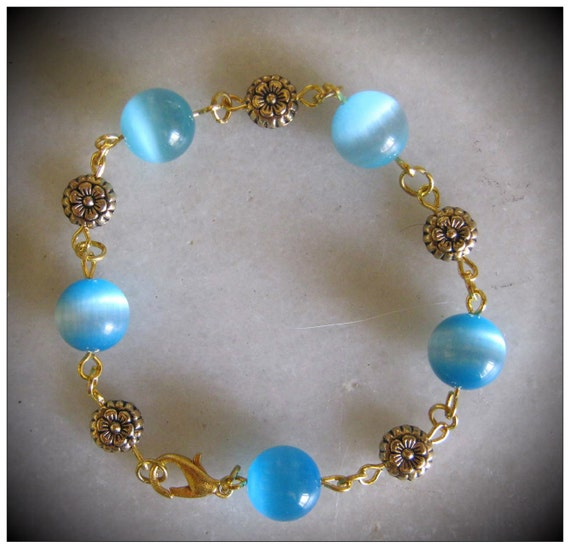 Handmade Gold Bracelet with Blue Cat Eye & Flowers by IreneDesign2011