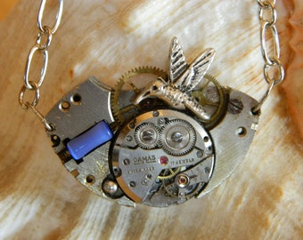 Silver colored steampunk jewelry necklace Hummingbirds, gears, blue glass bead, basis of old pocket watch, steam punk handmade surprise gift