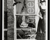 Black and White Photograph, Diorama, Window scene with paper doll, hummingbird, and woman in a boat