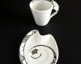 Set of 2 espresso cups with black&white geometrical design and silver stars