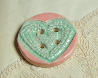 Heart buttonturquoise and peach.....she is a sew on button