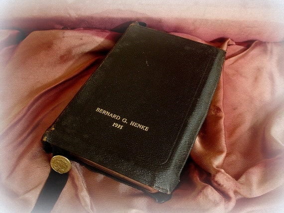 vintage leather bound lutheran hymn book . black leather with gold imprinted name and date 1935 . lutheran ss book mark