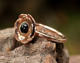 Rose gold plated silver ring with silver flower and black onyx center