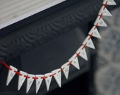 Porcelain Happy Christmas Garland, real gold lustre, red ribbon