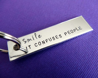 Smile It Confuses People Keychain - Hand stamped Keychain Accessory