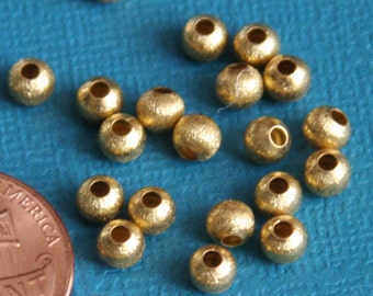 100 pcs of Gold plated round brush beads 4mm