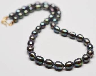 Hand knotted black rice pearls on silk