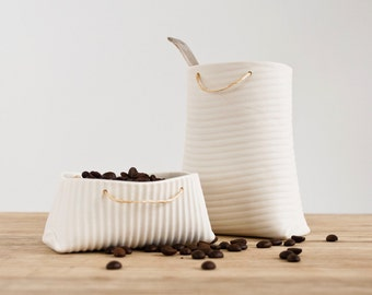 Porcelain container with stripes pattern (medium vessel). Porcelain bag collection by Wapa Studio.