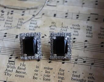 VINTAGE  earrings with a jet black rectangular black stone edged in rhinestones.