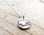 Tiny Nebraska necklace, silver state jewelry map pendant