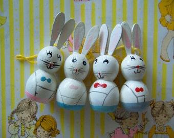four adorable wooden bunnies