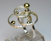 Sterling silver, kinetic, spinning, statement, cocktail ring with brass accents, novelty, gift