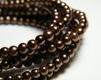 3mm round brown glass pearls, strand aprox. 26 inches