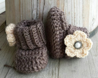 Crochet baby girl boots, in brown with tan flower and pearl button center. size 0 to 3 mo.