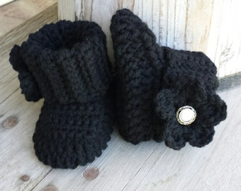 Crochet baby girl boots, in black with black flower and pearl button center. size 0 to 3 mo.