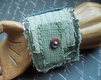Green Textile Cuff with 2 Brown 1 Tan Buttons