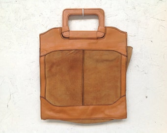 Worn leather handbag . Soft terra cotta suede . For iPads, laptops, library . Back to school