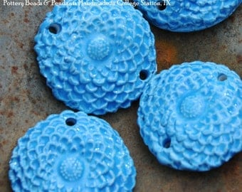 2 Pottery Flower Beads in Neon BLue