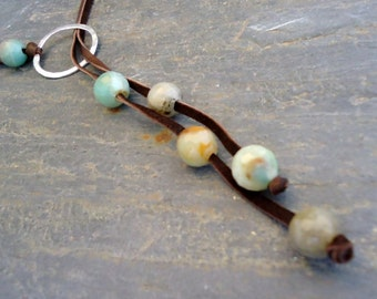 Amazonite sterling silver circle lariat on deerskin