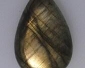 Labradorite pear cabochon with greenish gold color flash, 25.38 carats                   043-13-337