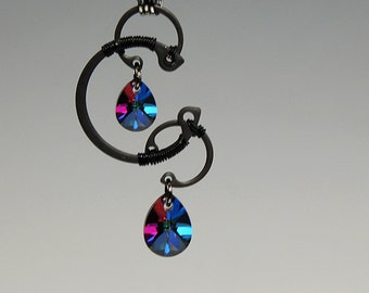 Io v8: Bold sphinx Swarovski crystal industrial wire wrapped Pendant