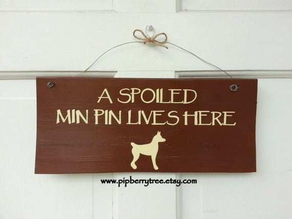 Hand Painted Wooden Sign - A Spoiled Min Pin Lives Here